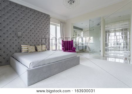 Luxurious simple bedroom interior full of space