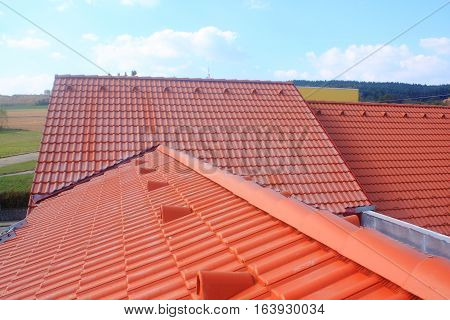 The roof is covered with red roofs of concrete tiles