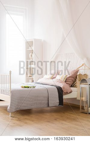 Bedroom With Bed And Window