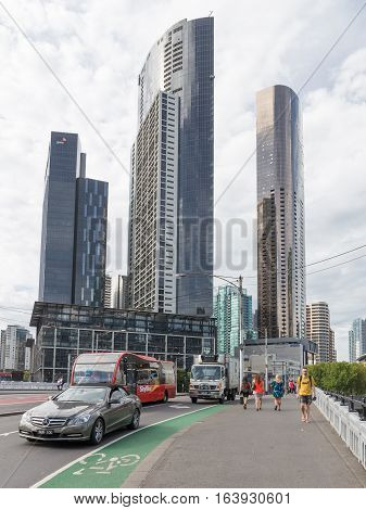 Melbourne - February 23 2016: William Street and the bridge over the river and Yarru view of skyscrapers and tourists strolling February 23 2016 in Melbourne Australia