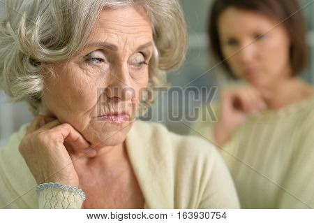 Portrait of senior woman thinking looking at the distance