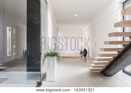 White Villa Interior With Staircase
