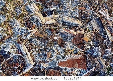 Ice, hoarfrost, splinter, grass on frozen ground