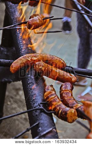 The traditional roast sausage on fire during the manifestations.
