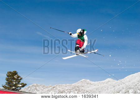 Skier High In The Air Cross Feet