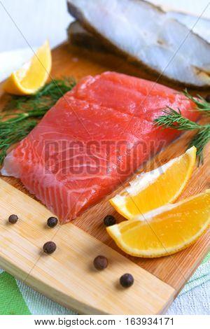 Fish , salmon, halibut and lemon closeup
