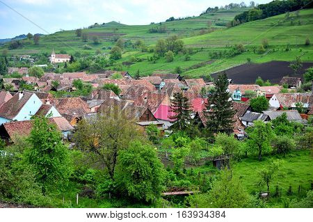 Summer view of an typical village in Transylvania Romania