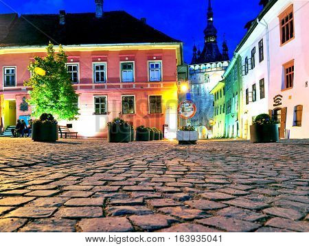 SIBIU ROMANIA - MAY 5: Night view of city square of Sighisoara Romania on May 5 2016. Sibiu is the city located in Transylvania region of Romania.