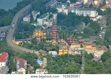 Aerial view of Jiming Temple and Nanjing City Wall, Nanjing, Jiangsu Province, China. Jiming Temple was first built in 557, and is one of the most antique and renowned Buddhist temples in Nanjing.