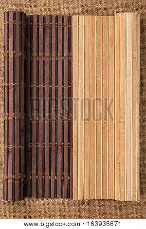 Two bamboo mat twisted in the form of a manuscript on sackcloth with space for your text