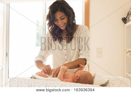 Mother Changing Baby's Diaper