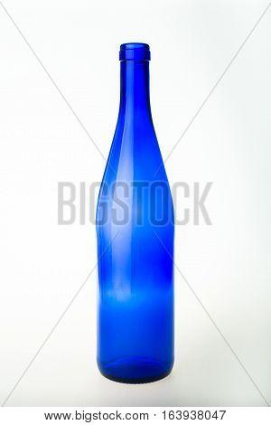 Empty blue wine bottle on white background.