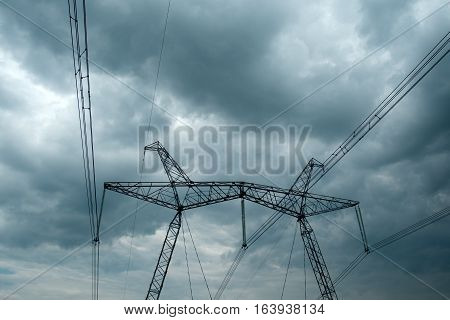 High-voltage power line against the dramatic sky. High voltage post. High-voltage tower sky background.