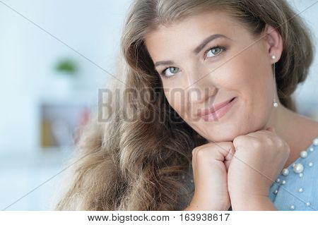 Portrait of a beautiful young woman, close up