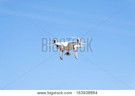 Drone against the blue sky Drowned drone accident. Drone in water.  A drone dramatically crashing into the water