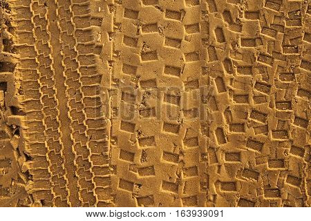 Cars and ATV traces on a sand road