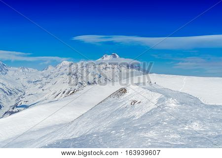 Winter in Greater Caucasus Mountains. Georgia (country). Gudauri ski resort. View from Mt. Sadzele.