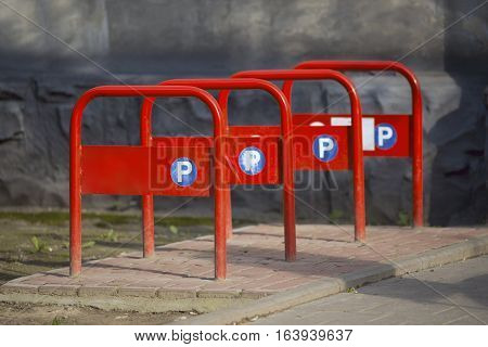 Empty bicycle rack for parking bicycles. U-type red bicycle parking.