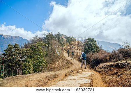 Trekking in Nepal. Group of people trekking on Annapurna mountain region Nepal