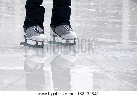 Still capture of recreational figure skater ice skates on outdoo