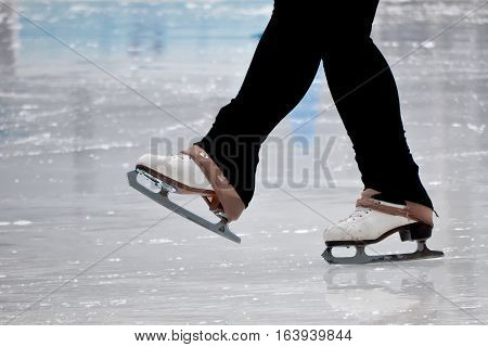 Still capture of recreational figure skater ice skates on outdoor rink