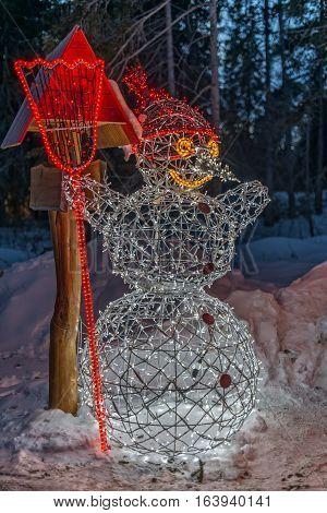 Winter in High Tatras Mountains. High Tatry. Slovakia. Christmas decoration, illuminated snowman