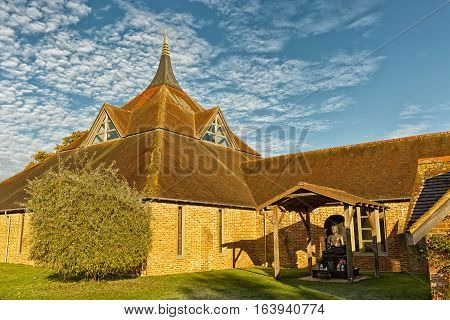 Hemel Hempstead England - November 2016: Photograph of Amaravati Buddhist Monastery at sunrise. The monastery is inspired by the Thai Forest Tradition and the teachings of the late Ajahn Chah a Thai monk a Thai monk and renowned Dhamma teacher.