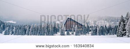 Winter in High Tatras Mountains. High Tatry. Slovakia. Vysoke Tatry. Frozen lake winter trees panorama. Lot of snow.