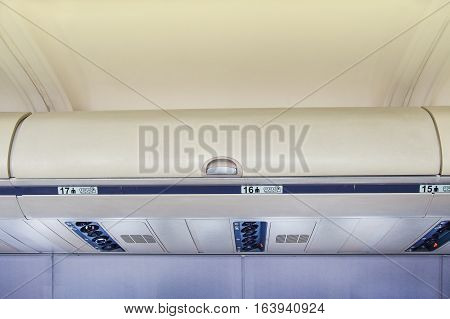 hand-luggage compartment with hand-luggage in an airplane
