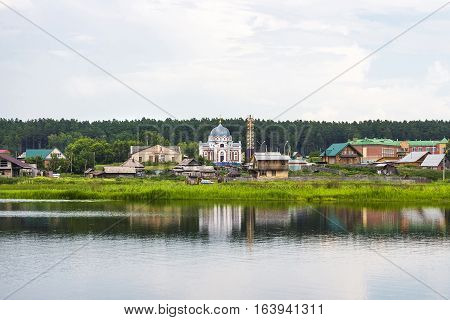 River Karakan the village of Zavyalovo Novosibirsk oblast Siberia Russia - July 7 2016: a view of the ancient Siberian village across the river