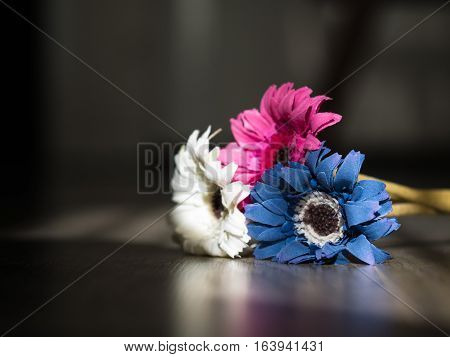 White pink and blue flower on a rustic wooden floor love concept