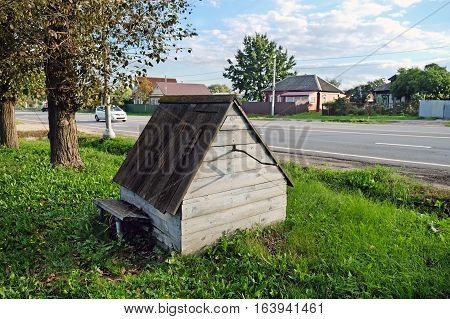 LUHOVITCI RUSSIA - SEPTEMBER 01 2016: Obsolete village well in the contemporary village on the side of the highway