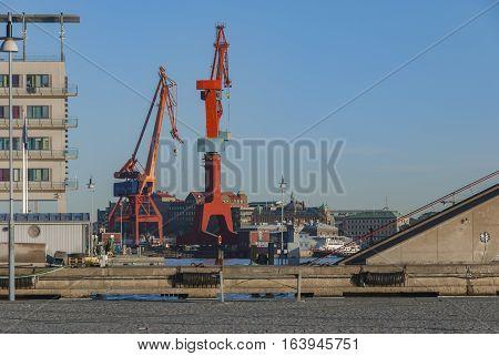 Cranes in Gothenburg city, transportation industry in Sweden