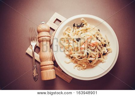 plate of vegetarian spaghetti with spinach and chilli