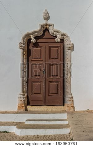 Historically church door of the Alvor Mother Church dedicated to divine Savior Alvor Portugal.