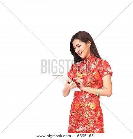 Beautiful Asian girl in Chinese qipao traditional dress using digital tablet Chinese new year and modern technology concept isolated on white background