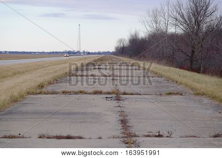 An abandoned portion of Route 66 in central Illinois has been closed and the new highway runs right next to it.