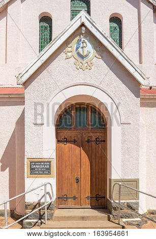 KOFFIEFONTEIN SOUTH AFRICA - DECEMBER 24 2016: Entrance of the Dutch Reformed Church in Koffiefontein (coffee fountain) a diamond mining town in the Free State Province