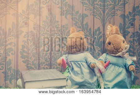 Vintage Rabbit doll with copy space on wall paper.