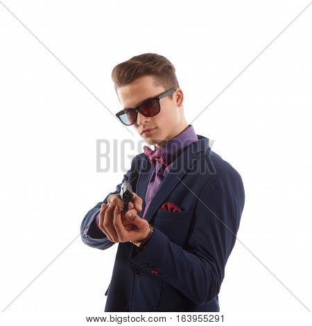 A young formal criminal holding a pistol