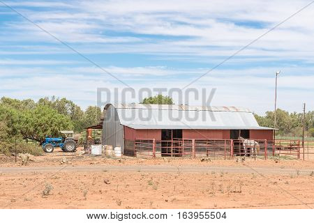 JACOBSDAL SOUTH AFRICA - DECEMBER 24 2016: A farm scene with tractor barn and horse near Jacobsdal a small town in the Free State Province