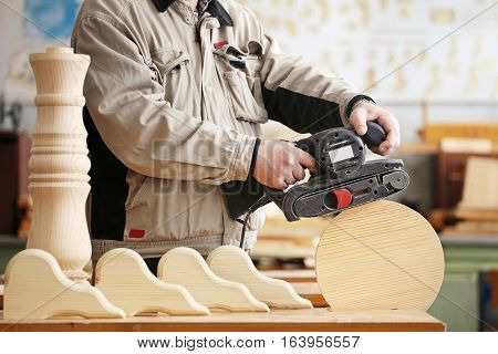 Man doing woodwork in a carpentry. Woodworker