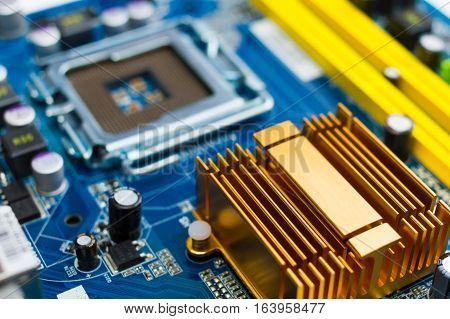 computer pc motherboard detail closeup - focus on heatsink