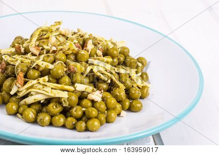 Healthy and diet food without meat: Green peas and cheese in pesto sauce. Studio Photo