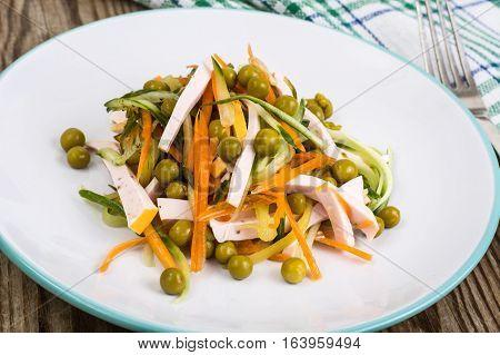 Salad with fresh vegetables and sausage. Studio Photo
