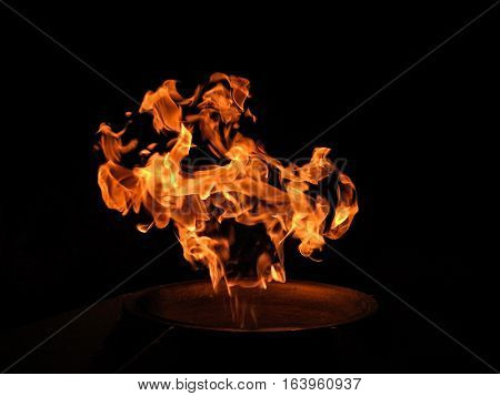 eternal flame with a bronze star with a black background