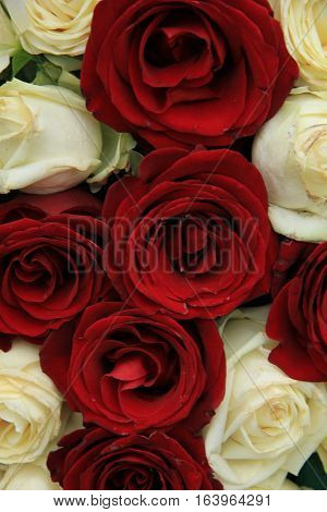 Red and whte roses in a wedding centerpiece