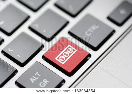 Obtain online financing concept with currency symbols held by a hand coming out of a laptop's display