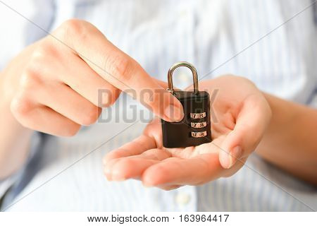 Business woman holding a cipher lock in her hands suggesting life insurance or personal security