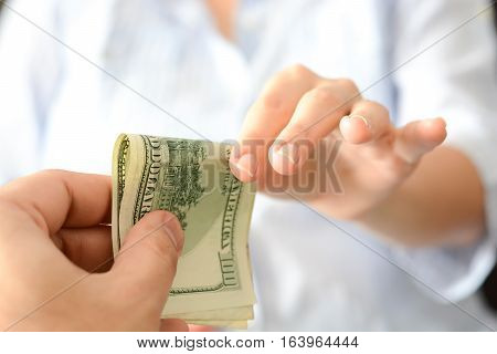 Give money to someone as bribe to suggest a corrupt system
